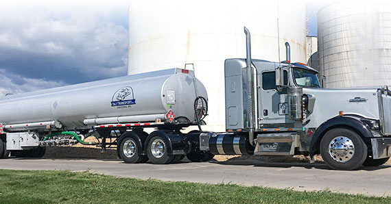 Commercial liquid fuel tanker with divided compartments